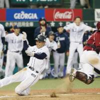 Asamura's sayonara double sends Lions past Eagles