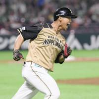 The Fighters' Sho Nakata rounds the bases after bashing a three-run homer in the top of the 10th inning on Thursday against the Hawks at Yafuoku Dome. Hokkaido Nippon Ham defeated Fukuoka SoftBank 5-4. | KYODO
