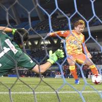 Shimizu S-Pulse's Shota Kaneko scores a first-half goal against Kawasaki Frontale on Friday night. It was the 20,000th goal in J. League first-division history. | KYODO