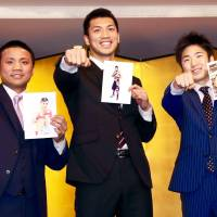 Boxers Ryota Murata (center) Daigo Higa (left) and Kenshiro Teraji pose for photos during a news conference on Monday. All three will be fighting for world titles on May 20. | KAZ NAGATSUKA