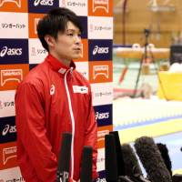 Kohei Uchimura speaks to the media after his practice in Tokyo on Wednesday. | KAZ NAGATSUKA