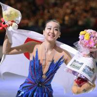 Mao Asada smiles for the crowd at Saitama Super Arena after winning her third world title in March 2014. On Monday, the figure-skating superstar announced her decision to retire.   KYODO