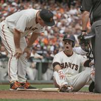 Posey appears OK after getting beaned in head