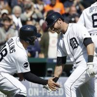 Romine slam powers Tigers past Twins