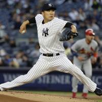Tanaka delivers solid outing against Cardinals