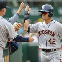Norichika Aoki returns to the bench after scoring against the A's on Saturday. | KYODO
