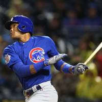 Heyward, Russell power Cubs past Pirates