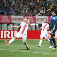 Japan's Mina Tanaka (far right) scores her team's second goal in a 3-0 win over Costa Rica in Kumamoto on Sunday. | KYODO