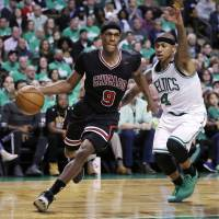 Chicago's Rajon Rondo (left) drives past Boston's Isaiah Thomas during the Bulls' 111-97 win in Game 2 of their playoff series on Tuesday. | AP
