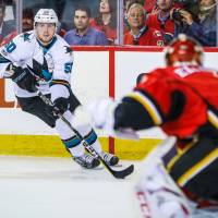 Flames clinch playoff spot