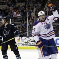 Lucic buries Sharks with third-period hat trick