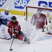 Wilson scores in OT as Caps rally past Leafs