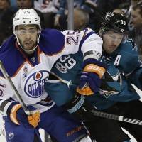 Sharks thrash Oilers to even series