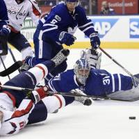Johansson scores twice as Capitals advance to East semis