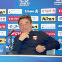 Urawa Reds goalkeeper Shusaku Nishikawa (left) and manager  Mihailo Petrovic speak to reporters on Tuesday, a day before the J. League squad's Asian Champions League match against the West Sydney Wanders in Saitama. | KYODO