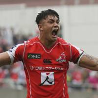 The Sunwolves' Rahboni Warren-Vosayaco celebrates after the team's victory over the Bulls at Prince Chichibu Memorial Ground on Saturday. | AP
