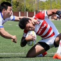 Japan's Ryuji Noguchi scores a try against South Korea during the Asia Rugby Championship's opening game on Saturday in Incheon, South Korea. | KYODO