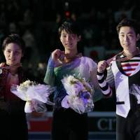 Runner-up Shoma Uno (from left), gold medalist Yuzuru Hanyu and third-place finishers Jin Boyang of China pose with their medals during the awards ceremony on Saturday at the world championships in Helsinki.   AP