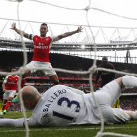 Arsenal rallies for draw against Manchester City