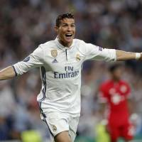 Cristiano Ronaldo celebrates after scoring in Real Madrid's Champions League quarterfinal, second-leg win over Bayern Munich on Tuesday. | AP