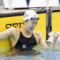 Yui Ohashi celebrates her victory in the women's 400-meter individual medley on Friday at the national championships.   KYODO