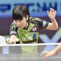 Miu Hirano plays a shot against Cheng Ming of China in the women's final at the Asian table tennis championships on Saturday in Wuxi, China. Hirano defeated Cheng 11-9, 11-8, 11-7. | KYODO