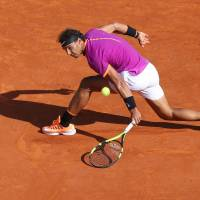 Umpire's ruling mars Nadal's semifinal victory over Goffin