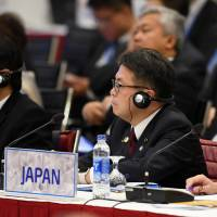 Trade minister Hiroshige Seko and his counterparts from the Asia-Pacific Economic Cooperation forum attend a meeting Saturday at the National Convention Center in Hanoi. | REUTERS