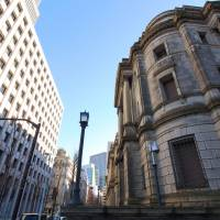 To reduce paperwork, BOJ eyes paying banks more for electronic treasury transactions