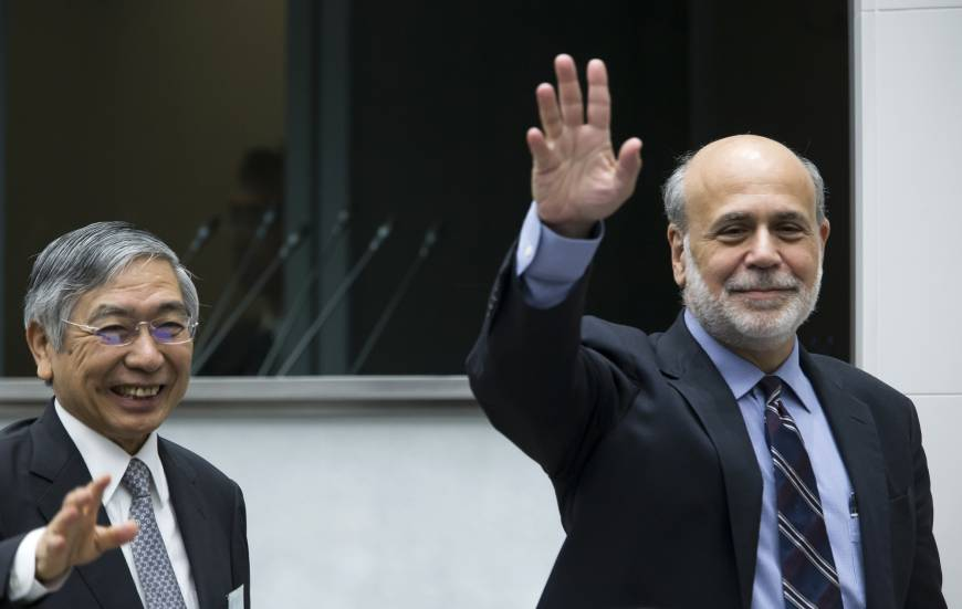 Bank of Japan Gov. Haruhiko Kuroda and Ben Bernanke, former chairman of the U.S. Federal Reserve, wave during the 2017 BOJ-IMEF Conference at the Bank of Japan headquarters in Tokyo on Wednesday. | BLOOMBERG