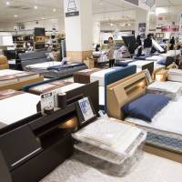 Beds sit on display at a Nitori Holdings Co. store in Tokyo on April 25. | BLOOMBERG