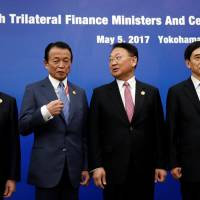 Finance chiefs of Japan, China, South Korea pledge to 'resist all forms of protectionism'