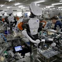 Desperately short of labor, midsized firms plan to buy robots
