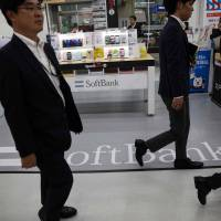 SoftBank Group Corp.'s net profit in the year that ended March 31 more than tripled from a year earlier. | AFP-JIJI