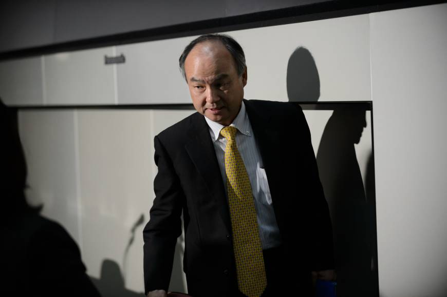 Masayoshi Son, chairman and chief executive officer of SoftBank, leaves a news conference at the Tokyo Stock Exchange in Tokyo on May 10.   BLOOMBERG