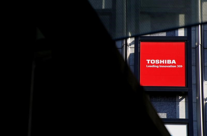 The Toshiba Corp. logo is seen outside an electronics retailer in Tokyo in February. | REUTERS