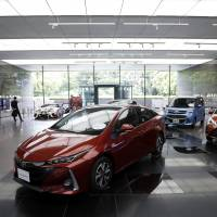 Toyota Motor Corp. expects a downward trend in earnings to continue through the business year to March 2018. | BLOOMBERG