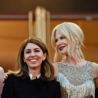 Actress Elle Fanning, director Sofia Coppola and actress Nicole Kidman smile as they arrive on May 24 for the screening of the film 'The Beguiled' at the 70th edition of the Cannes Film Festival. | AFP-JIJI
