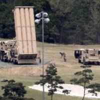 The U.S. Terminal High Altitude Area Defense (THAAD) anti-missile system is installed at a golf course in Seongju, South Korea, on May 2. | YONHAP / VIA AP