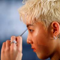 A member of Acrush prepares for the band's maiden news conference in Beijing on April 28.   REUTERS