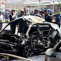 Islamic State-claimed suicide blasts kills 27 in Baghdad as battle to liberate Mosul turns cautious