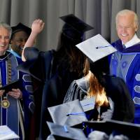 Biden tells grads it's time to end divisions after an election that churned up 'ugliest realities'