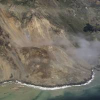 Massive landslide buries stretch of iconic California highway