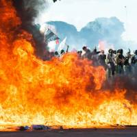 Embattled Brazilian president sends out troops as protests rage