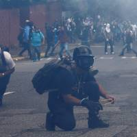Caracas May Day tense after deadly unrest, demands for Maduro's ouster