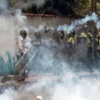 Venezuela descends further into deadly unrest as students rally, attorney general quits