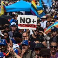 Protesters again shut down Caracas in 'sit-in against dictatorship' as violence mounts