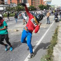 Doctors join fresh Venezuela clashes as embattled president calls for counterdemonstration