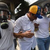 Soldiers tear-gas Venezuela opposition leader Capriles at protest