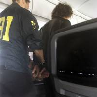 Turkish national subdued after approaching cockpit of U.S. plane en route to Hawaii